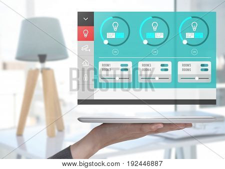 Digital composite of Hand holding tablet and a Home automation system lighting App Interface