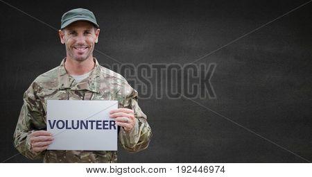 Digital composite of Soldier volunteer against grey wall