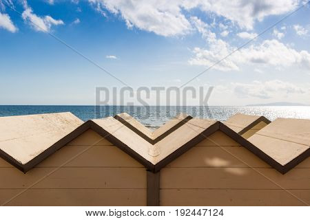 Follonica beach and bathing huts in front of Thyrrenian sea Italy