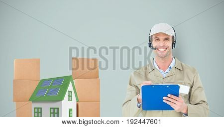 Digital composite of Smiling delivery man holding clipboard by house and parcels