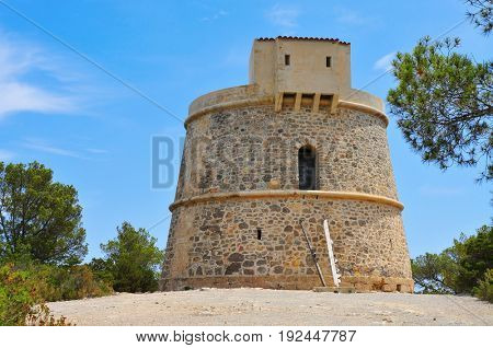 a view of the medieval tower Torre de Campanitx or Torre den Valls, in Ibiza, Spain