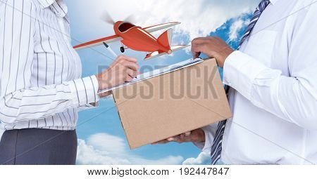 Digital composite of Midsection of delivery man taking sign of woman while delivering parcel with airplane in background
