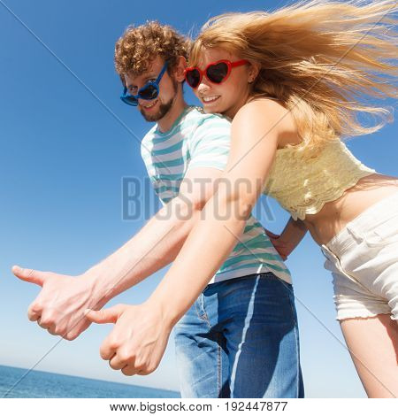 Happiness dating concept. Couple in love blonde woman bearded man enjoy date making thumb up hand gesture outdoor wide angle view