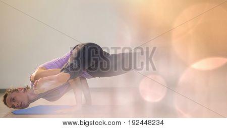Digital composite of Athlete exercising on yoga mat