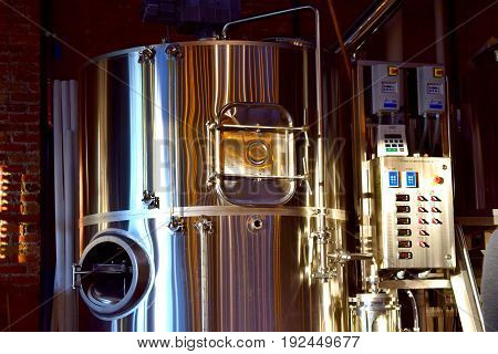 Behind the scenes of a brewing company's beer tank.