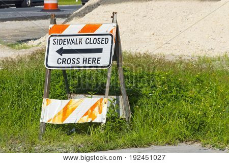 Sidewalk Closed Signage Due to Construction of road repairs
