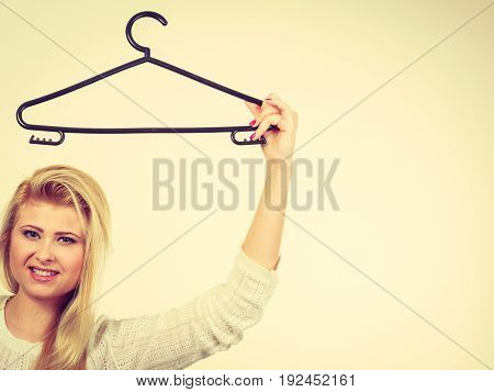 Woman Holding Clothes Hanger