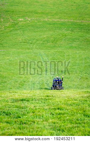 Two girls driving a Go Kart in a field on a farm in Virginia