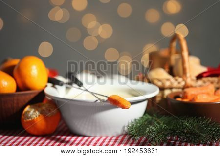 Bowl with cheese fondue on festive table