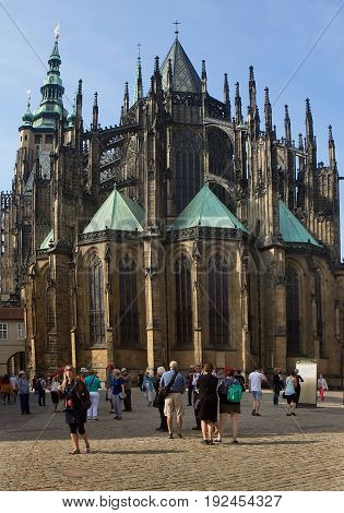 Prague - September 26 2016: An unidentified people near Eastern facade of St Vitus Cathedral in Prague.