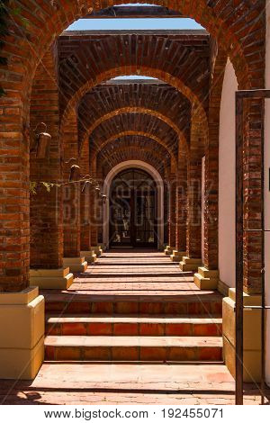 ENSENADA, MEXICO - MAY 3, 2017:  Rows of arches of the Adobe Guadalupe Winery and Inn in Baja California's Valle de Guadalupe, near the town of El Porvenir.