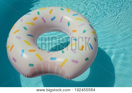 one swim ring floating on the swimming pool in holiday
