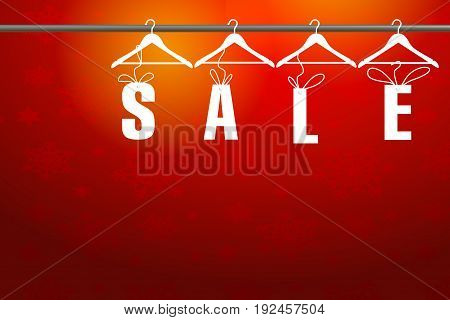 White sale word hanging on hanger with red background.