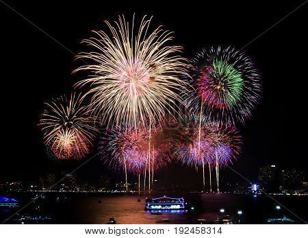 Fireworks over cityscape by the beach and sea surrounding with hotels restaurant and service boats and cruises for celebrating New Year eve and special occasion on holidays