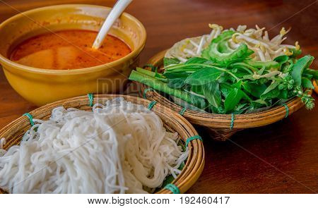 Kanom Jeen Thai rice vermicelli served with curry and vegetable