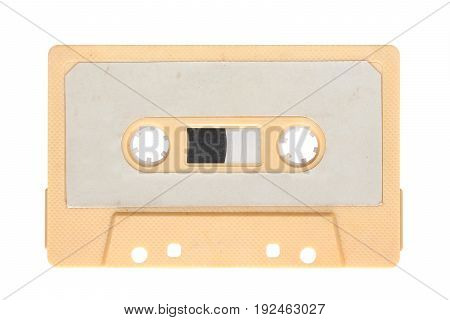 Image of yellow audio cassette isolated on background