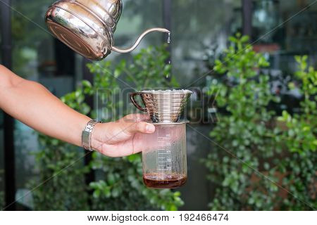 Barista dripping coffee drip using hot water