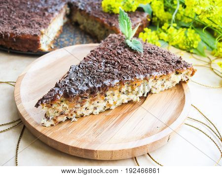 Homemade cake or pie with ricotta cheese, poppy seeds, apricot jam and dark chocolate, selective focus