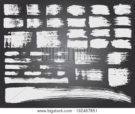 Vector Set of brush acrylic strokes. White color on black background. Hand painted grange elements. Ink drawing. Dirty artistic design . Place for text, quote, information, company name