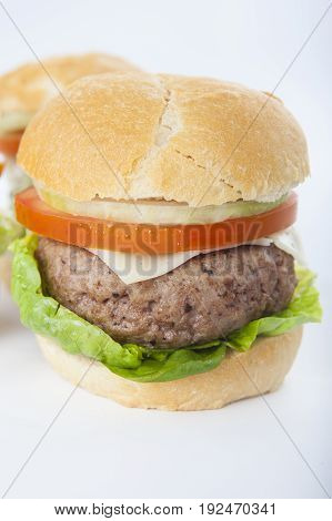 Giant Homemade Burger Classic American Cheeseburger Isolated On White