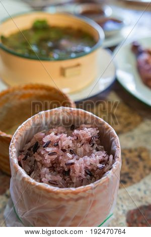 Thai sticky brown rice served in a local ware