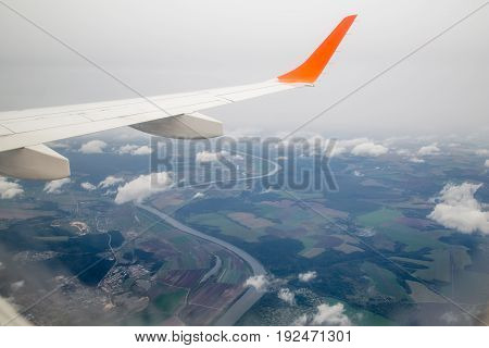 Photographing from a plane window. Flying a plane over the clouds