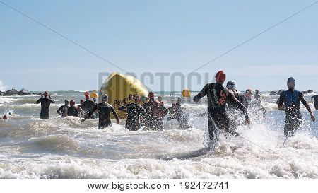 Pescara Italy - June 18 2017: Starting for the swimming test of the athletes of the Ironman 70.3 Pescara of June 18 2017