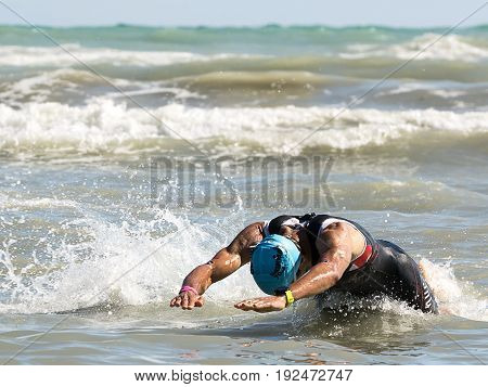 Pescara Italy - June 18 2017: athlete at swimming test of the Ironman 70.3 Pescara of June 18 2017