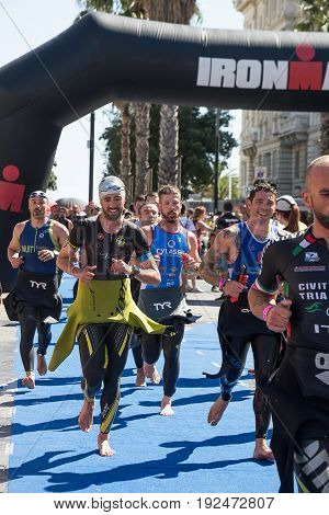 Pescara Italy - June 18 2017: Athletes in the transition area between swimming and bike at Pescara's Ironman 70.3