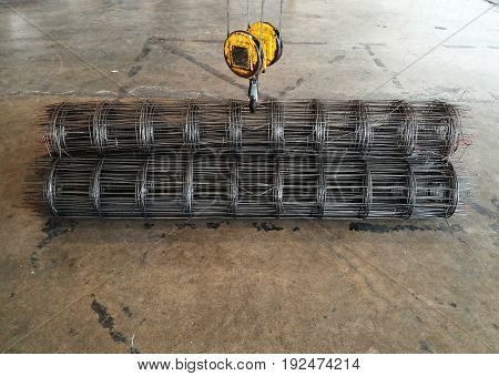 big yellow hook of crane lift up wire mesh