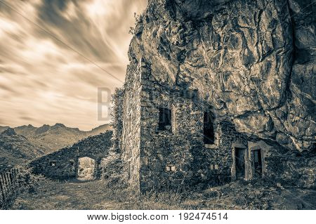 Black & white image of 17th century bandit's house