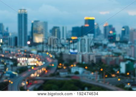Aerial view Bangkok city blurred bokeh light night view abstract background