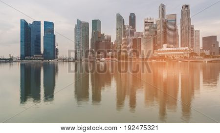 Singapore city central business downtown with water reflection ligh effiect cityscape background