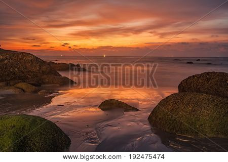 A long exposure shot of beautiful sunset tropical beach in Thailand