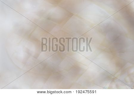 Beautiful abstract dreamy blurred mother of pearl background with peach and lilac colours