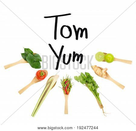 Thai delicious spicy & sour Tom Yum dish's ingredients of lemon grass cilantro galangal kaffir lime leave limes spicy bird peppers & tomato isolated on white space background with Tom Yum wording