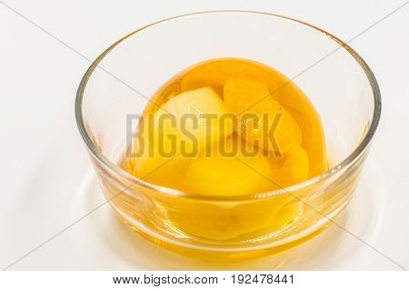 fruit jelly in a crystal bowl on white background