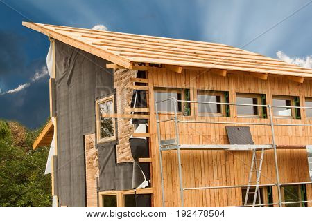 Ecological construction. Lining the house of larch boards. Heat insulation. Construction works