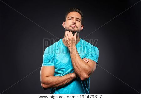A handsome young sportsman standing confidently with his arms crossed