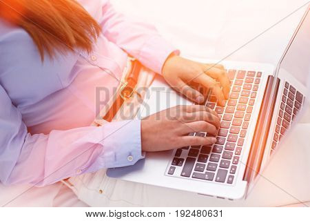 Close-up view of hands using laptop