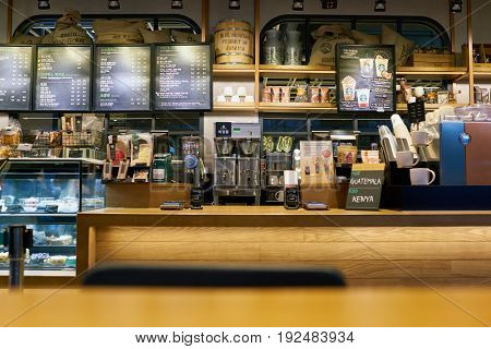 SEOUL, SOUTH KOREA - CIRCA JUNE, 2017: inside Starbucks coffee shop in Seoul. Starbucks Corporation is an American coffee company and coffeehouse chain.