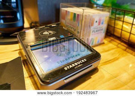 SEOUL, SOUTH KOREA - CIRCA MAY, 2017: a payment terminal at Starbucks coffee shop in Seoul. Starbucks Corporation is an American coffee company and coffeehouse chain.