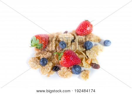 whole grain cereal flakes with mixed berry fruit and raisins. Cereal cornflakes isolate on white.