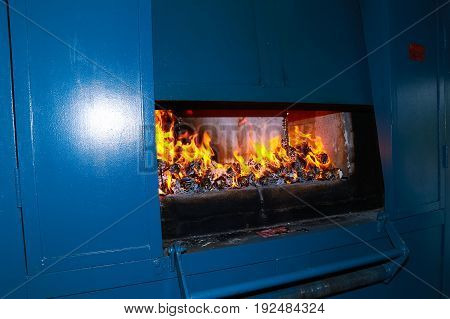 Coffin with be on fire in crematory.