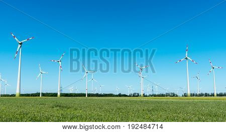 Wind power plant with many windmills seen in Germany