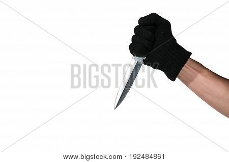 Hand with knife. Hand with black glove holding a dagger knife. Isolated on a white background.
