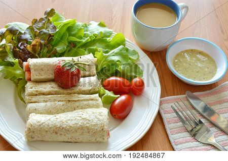 bread roll and salad dipping sauce with coffee for breakfast