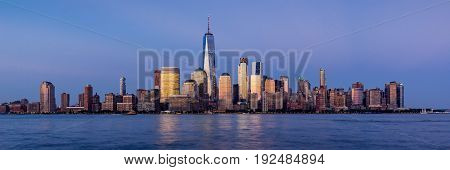 New York City Financial District skyscrapers and Hudson River at sunset. Panoramic view of Lower Manhattan