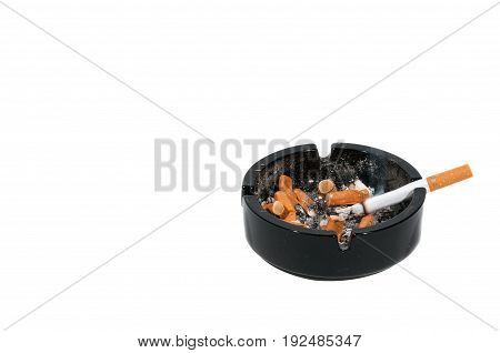 Ashtray. Dirty black ceramic ashtray with a cigarette, full of smoked cigarettes. Isolated on a white background.