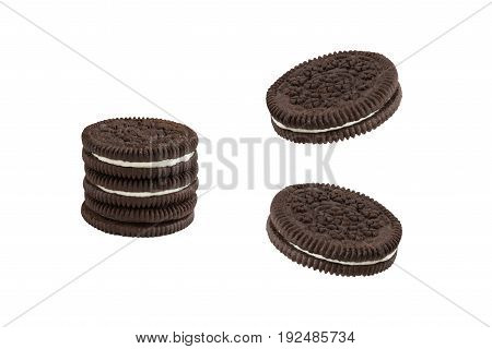 Cookies and cream chocolate cookies in stack and single pieces isolated on white background (clipping path included)